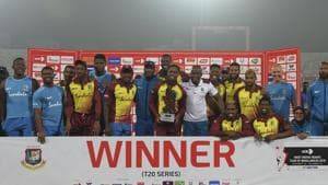 West Indies cricketers pose with the tournament trophy following the third Twenty20 (T20) cricket match between Bangladesh and West Indies at the Sher-e-Bangla National Cricket Stadium in Dhaka on December 22, 2018.(AFP)