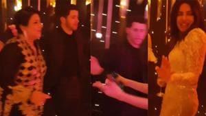 Madhu Chopra and Nick Jonas dancing together at his wedding reception in Mumbai.(Instagram)