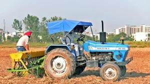 Farmers sowing wheat crop in their fields in Punjab's Zirakpur. Government data shows sowing of winter, or rabi crops, such as wheat is down by nearly 5% compared to the previous years (File Photo)(HT Photo)