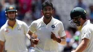 Australia's batsman Travis Head (R) walks off the field as India's paceman Jasprit Bumrah (C) celebrates his dismissal during day three of the third cricket Test match between Australia and India in Melbourne.(AFP)