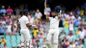 India vs Australia: Cheteshwar Pujara celebrates scoring his century on day one of the fourth test match between Australia and India at the SCG in Sydney, Australia, January 3, 2019(REUTERS)