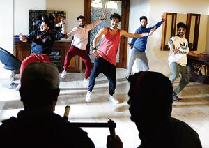 The culture in Mohali is encouraging, says Gurnazar Chattha, at centre above. Here, the singer and lyricist shoots his latest video, for a song called 'Kudi kudi', at an uncle's bungalow. Local music labels release as many as 30 songs online a day. The music itself costs very little to produce and distribute, and within the formula — catchy beat, young dancers, lyrics about alcohol / partying / romance / heartbreak — some returns are almost guaranteed.(Anil Dayal / HT Photo)