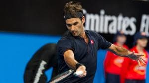 Roger Federer of Switzerland hits a return against Stefanos Tsitsipas of Greece during their men's singles match on day six of the Hopman Cup tennis tournament in Perth.(AFP)