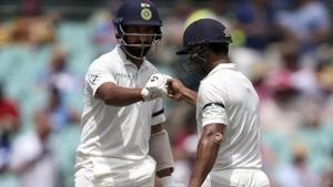 India's Mayank Agarwal, right, and Cheteshwar Pujara encourage each other.(AP)