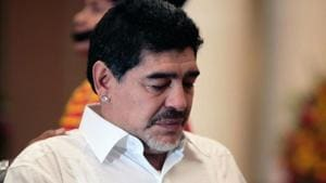 Argentina's soccer legend Diego Armando Maradona touches the tomb of late President Hugo Chavez in Caracas.(AFP)