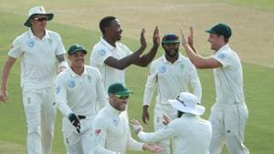 South Africa's Kagiso Rabada celebrates with team mates after taking the wicket of Pakistan's Babar Azam.(REUTERS)