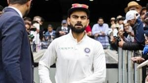 India's captain Virat Kohli walks up the player race during play on day five of the third cricket test between India and Australia.(AP)