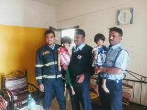 Frire brigade officials after rescuing twin sisters.(HT/PHOTO)
