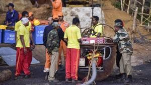 Rescue personnel conduct rescue task at the site of the coal mine collapse at Ksan, in Jaintia Hills district of Meghalaya.(PTI)