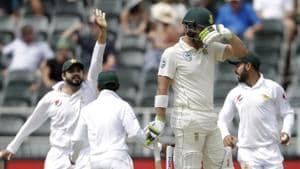 South Africa's batsman Dean Elgar, front, reacts as Pakistan players celebrates his wicket during day two of the third cricket test match between South Africa and Pakistan.(AP)