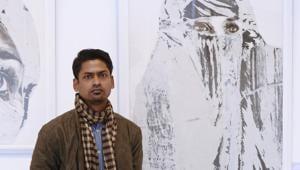 Artist Jyotiprakash Sethy poses next to his artworks(Sarang Gupta/HT)