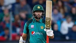 Pakistan batsman Imam Ul-Haq raises his bat as he celebrates scoring half century during the first One Day International (ODI) match against South Africa.(AFP)