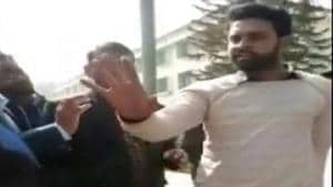 An FIR has been registered against NSUI Shahjahanpur district president Irfan Hussain for allegedly threatening a female student after she complained of molestation.(Screengrab of video where the NSUI district president of Shahjahanpur could be seen threatening the woman in front of the college staff.)