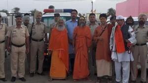 Z+ security, private guards: Saints at Kumbh Mela move under gun cover