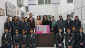 Founder and CEO of Panthalassa Mrinalini Mitra with the teachers and students of CMS, Gomti Nagar Extension, during the installation of a sanitary napkin dispensing machine at the institution.(Handout photo)