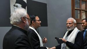 PM Modi receives cap once worn by Netaji from leader's family
