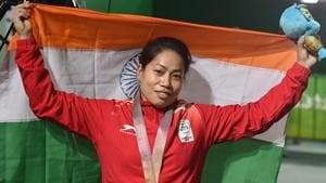 Sanjita Chanu poses with the tricolour for a photo after winning gold in the women's 53kg Weightlifting event.(PTI)