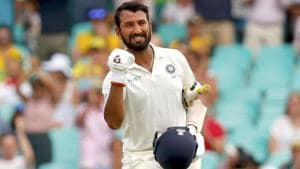 India's Cheteshwar Pujara celebrates his century during the first day of the final Test against Australia.(AFP)