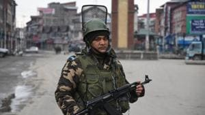 Security personnel stand guard during 70th Republic Day celebrations in Srinagar.(ANI)