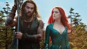 This image released by Warner Bros. Pictures shows Jason Momoa, left, and Amber Heard in a scene from the film, Aquaman.(AP)