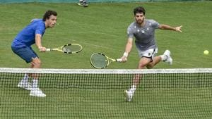 Italy's Marco Cecchinato and Simone Bolelli during a training session ahead of their Davis Cup match against India, in Kolkata.(AP)