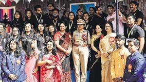 Tejaswini Satpute, DCP traffic, poses with students and staff at MIBM's fest Mangalya 7.0 in Shivajinagar on Monday.(Rahul Raut/HT PHOTO)