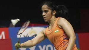 India's Saina Nehwal returns a shot to Spain's Carolina Marin during the final round of the women's single match the Indonesia Masters badminton tournament at Istora Stadium in Jakarta, Indonesia, Sunday, Jan. 27, 2019(AP)