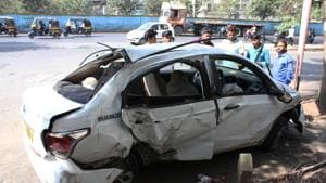 Two died and four were injured after the driver lost control of the car and hit a divider on the Manpada flyover in Thane on Thursday.(HT Photo)