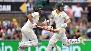 Australia batsmen Travis Head (left) and Joe Burns during their 308-run partnership on the first day of the second Test against Sri Lanka.(AFP)
