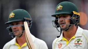 Australia's Joe Burns (R) and Travis Head walk back to the pavilion during a tea break on day one of the second Test cricket match between Australia and Sri Lanka at Manuka Oval Cricket Ground in Canberra on February 1, 2019.(AFP)