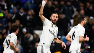 Real Madrid's French forward Karim Benzema celebrates scoring the opening goal during the Spanish league football match Real Madrid CF against Club Deportivo Alaves at the Santiago Bernabeu stadium(AFP)