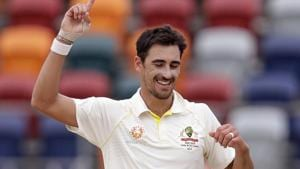 Australia's Mitchell Starc celebrates his 10th wicket against Sri Lanka on day 4 of their cricket test match in Canberra, Monday, Feb. 4, 2019. Australia won the test by 366 runs and the series 2-0(AP)