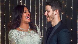 Priyanka Chopra with husband Nick Jonas pose for photos during their wedding reception, in Mumbai.(PTI)