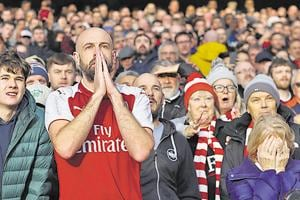 A tense Arsenal supporter during a match against Tottenham Hotspur in December last year.(Getty Images)