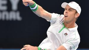 Sam Querrey of the US hits a return to Gilles Simon of France.(AFP)