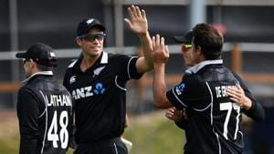 New Zealand's Tim Southee (L) celebrates with teammates after Bangladesh's Mahmudullah was dismissed during the third one-day international cricket match between New Zealand and Bangladesh at University Oval in Dunedin.(AFP)