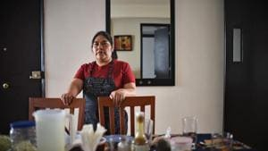 Mexican domestic worker Ignacia Ponciano poses at the house where she has worked for over 30 years in Mexico City on January 18, 2019. - The working conditions of domestics in Latin America, to whom director Alfonso Cuaron pays homage in his recent movie 'Roma', is slowly reaching a legal framework. Whilst several countries in the region have established laws for the sector in the last decade, other simultaneous realities such as economic crises and migration, are hampering those conquests and ambitions of formality. (Photo by Rodrigo ARANGUA / AFP)(AFP)