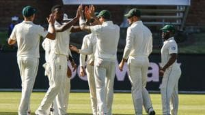 South Africa's Kagiso Rabada, second from left, celebrates with teammates after dismissing Sri Lanka's captain Dimuth Karunaratne.(AP)
