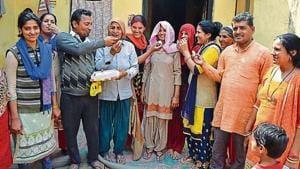 Sneha and Suman's family members celebrate in their village Kathikhera in Hapur district of Uttar Pradesh on Monday.(HT PHOTO)
