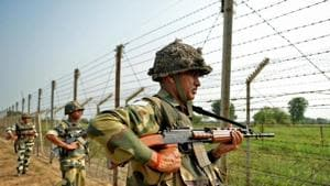 Indian Border Security Force (BSF) soldiers take up positions at an outpost along a fence at the India-Pakistan border. A Pakistani was among two Jaish-e-Mohammed (JeM) terrorists killed in a firefight with security forces in south Kashmir's Shopian on Wednesday, a police statement said.(AFP)