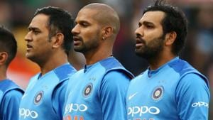 MS Dhoni, Shikhar Dhawan and Rohit Sharma of India sing the national anthem ahead of a match.(Getty Images)