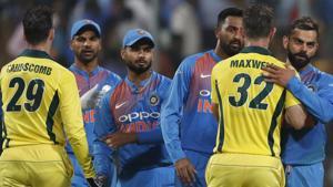 India's captain Virat Kohli, right, hugs Australia's Glenn Maxwell to congratulate him on their win in the second T20 international cricket match.(AP)