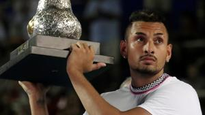 Australia's Nick Kyrgios celebrates winning the Acapulco Open with the trophy.(REUTERS)