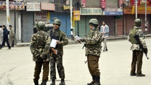 CRPF Personnel stand guard in front of closed market during strike in Srinagar on Tuesday.(Imran Nissar)