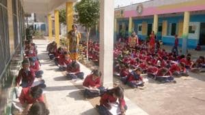 Students at a government school in Almora district have been giving board examinations sitting on the floor due to lack of furniture.(HT file/For representation only)