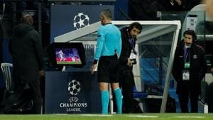 Referee Damir Skomina reviews an incident on VAR before awarding a penalty to Manchester United against PSG on Wednesday.(Action Images via Reuters)