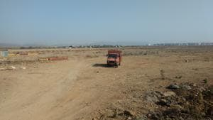 The land at Dastan Phata is being levelled for construction work.(HT PHOTO)