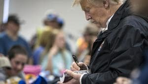 Donald Trump signed several hats and Bibles, including one for a 12-year-old boy, an action which drew applause from people who came to see the President.(NYT)