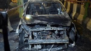 A view of the car that caught fire, resulting the death of three persons, near Akshardham Mandir flyover.(Sushil Kumar/HT PHOTO)