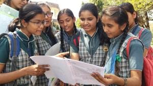 Students discussing question paper after writing exam of Chemistry CBSE class12th at Jawahar Lal Nehru H S school in Bhopal, India, on Tuesday,(Mujeeb Faruqui/HT Photo)